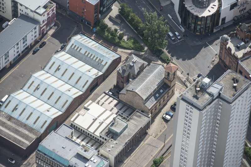 Oblique aerial view of Cowcaddens Free Church and Scottish Ambulance Service, looking SSE.