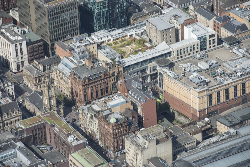 Oblique aerial view of the Britannia Building, St George's Tron Parish Church and Nelson Mandela Place, looking WNW.