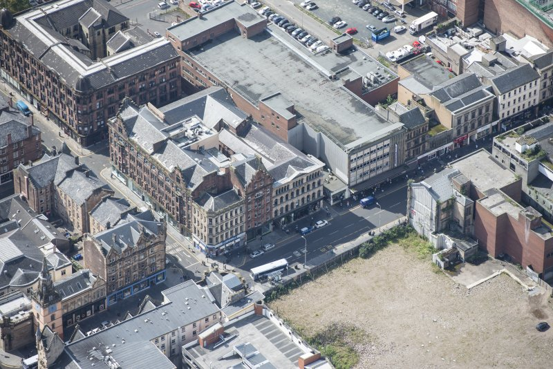 Oblique aerial view of the Britannia Music Hall and Tron Steeple, looking SW.