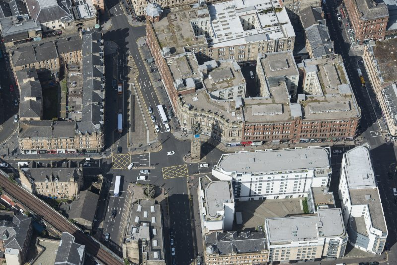 Oblique aerial view of the Trongate, Tolbooth Steeple and Mercat Building, looking WNW.