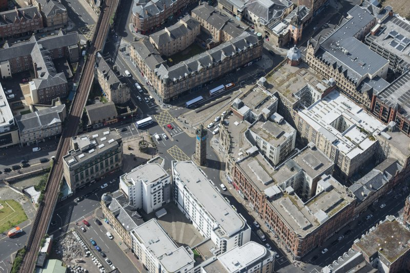 Oblique aerial view of the Trongate Tolbooth Steeple, Mercat Building and Mercat Cross, looking SW.