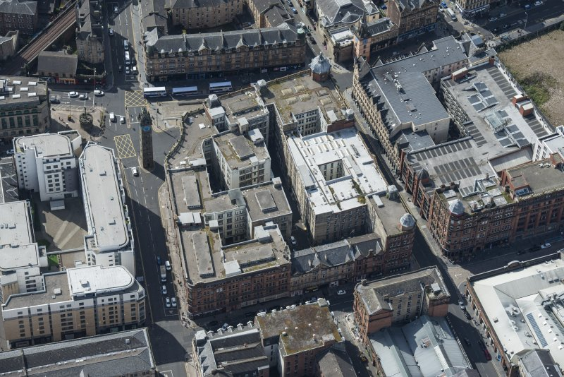 Oblique aerial view of the Trongate and Tolbooth Steeple, looking SW.