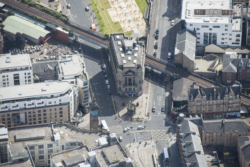 Oblique aerial view of the Trongate, Tolbooth Steeple and Mercat Building, looking SSE.
