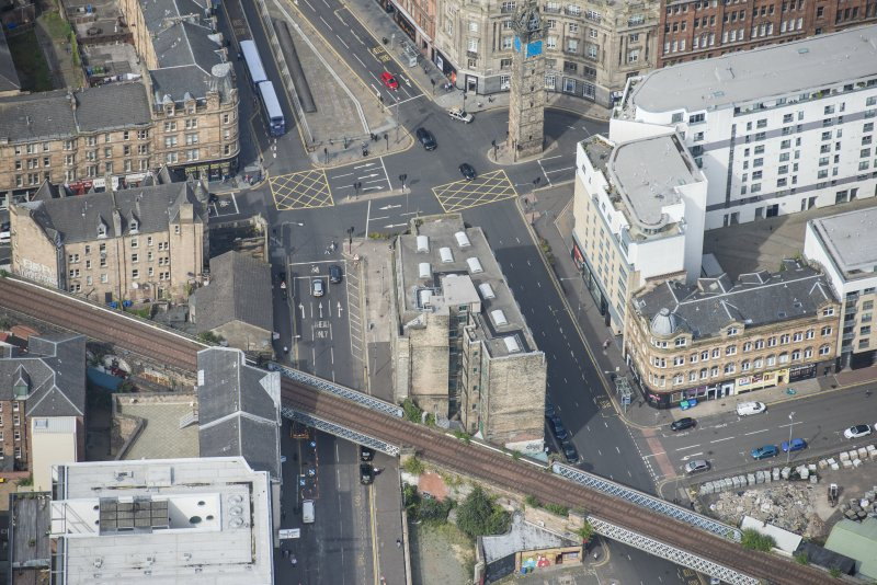Oblique aerial view of Trongate Tolbooth Steeple, Town Hall and Tontine Hotel, looking NNW.