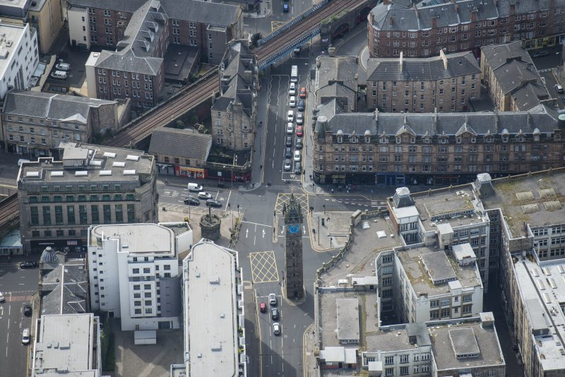 Oblique aerial view of Trongate Tolbooth Steeple, Town Hall and Tontine Hotel, looking SW.