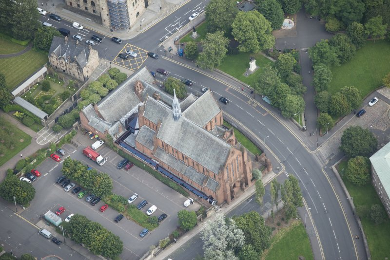 Oblique aerial view of Barony Parish Church and Statue of King William III, looking ENE.