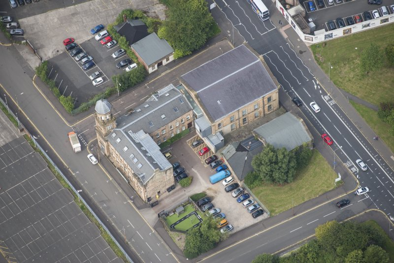 Oblique aerial view of Kirkhaven Church, looking NW.