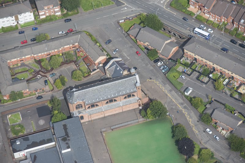 Oblique aerial view of Sacred Heart Church and Presbytery, looking NNE.