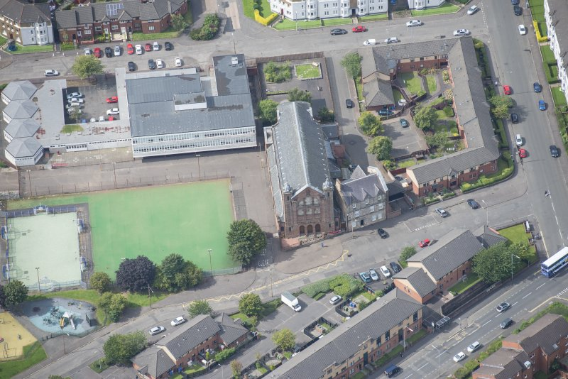 Oblique aerial view of Sacred Heart Church and Presbytery, looking W.