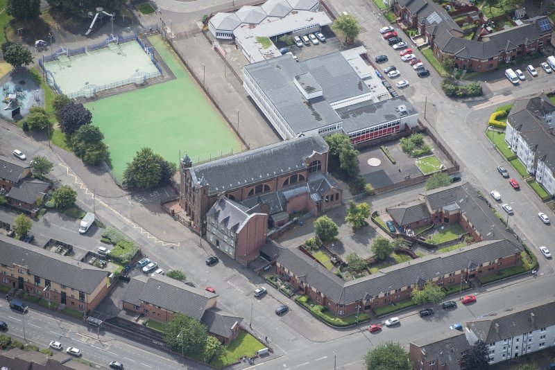 Oblique aerial view of Sacred Heart Church and Presbytery, looking SSW.