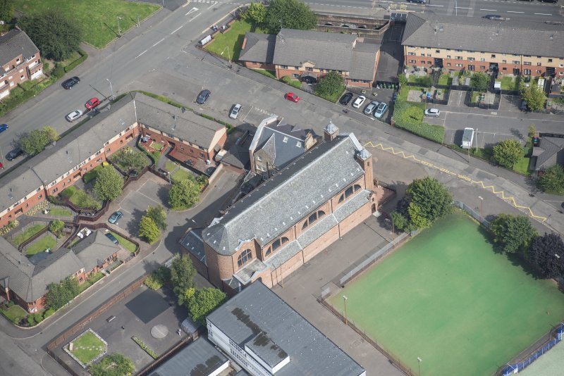 Oblique aerial view of Sacred Heart Church and Presbytery, looking NE.