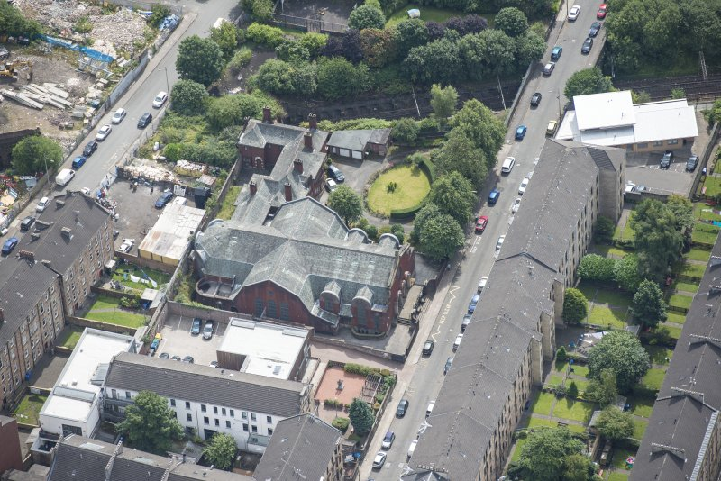 Oblique aerial view of St Anne's Roman Catholic Church and Presbytery, looking SSE.