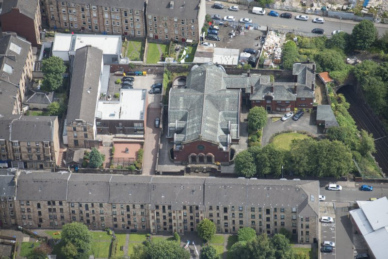 Oblique aerial view of St Anne's Roman Catholic Church and Presbytery, looking E.