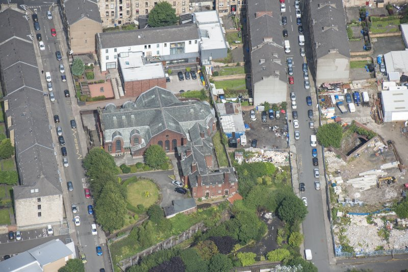 Oblique aerial view of St Anne's Roman Catholic Church and Presbytery, looking NNE.
