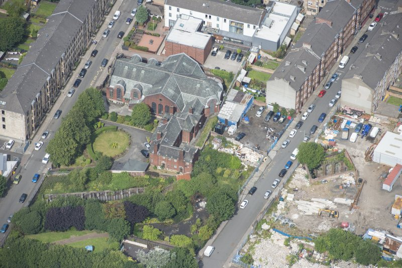 Oblique aerial view of St Anne's Roman Catholic Church and Presbytery, looking NNW.