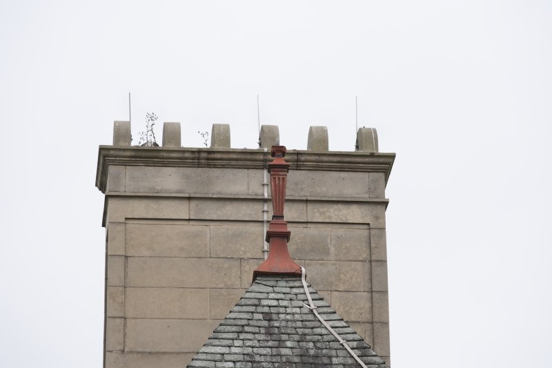Detail of finial and chimney stack on the south elevation.