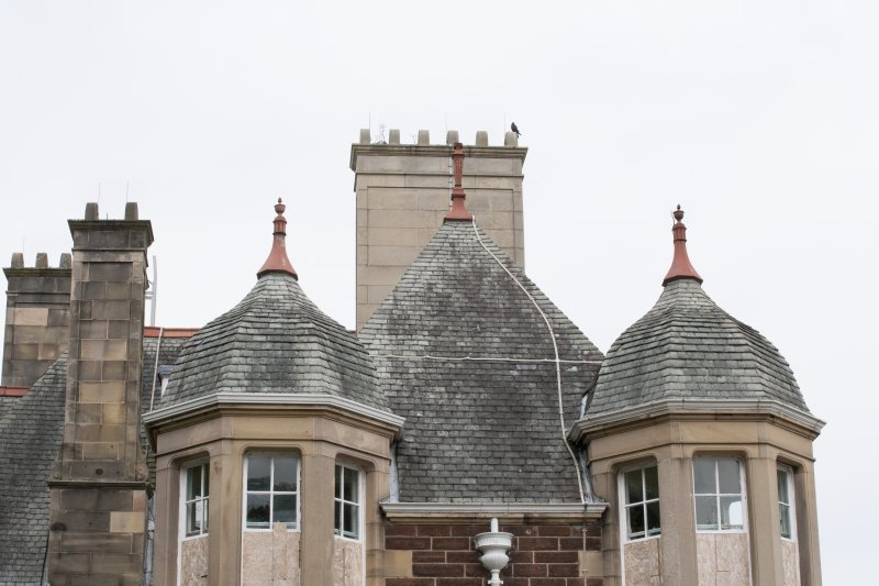 Details of finials and chimney stack on the south elevation.