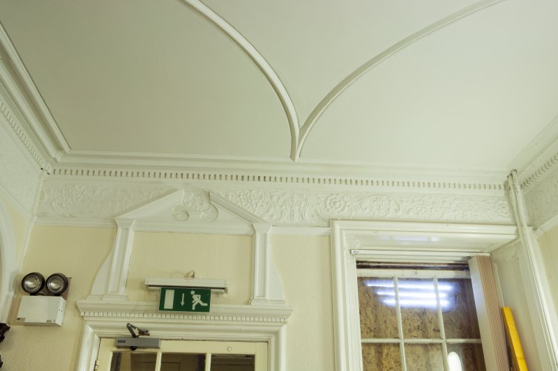 Interior. Detail of frieze, ceiling, pediment and cornice in main hall..