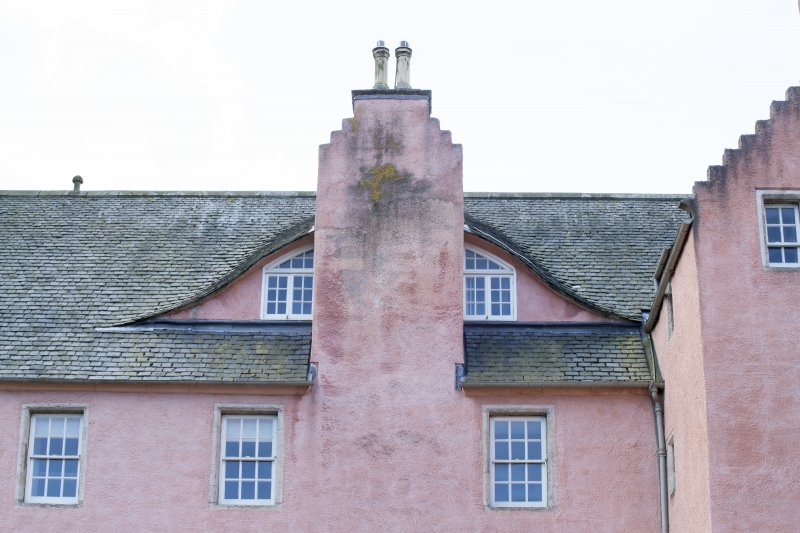 Detail of east facing shiminey stack and windows.