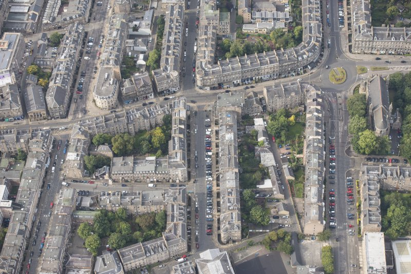 Oblique aerial view of Forth Street, Albany Street, Broughton Street, Hart Street, East London Street and Catholic Apostolic Church, looking SW.