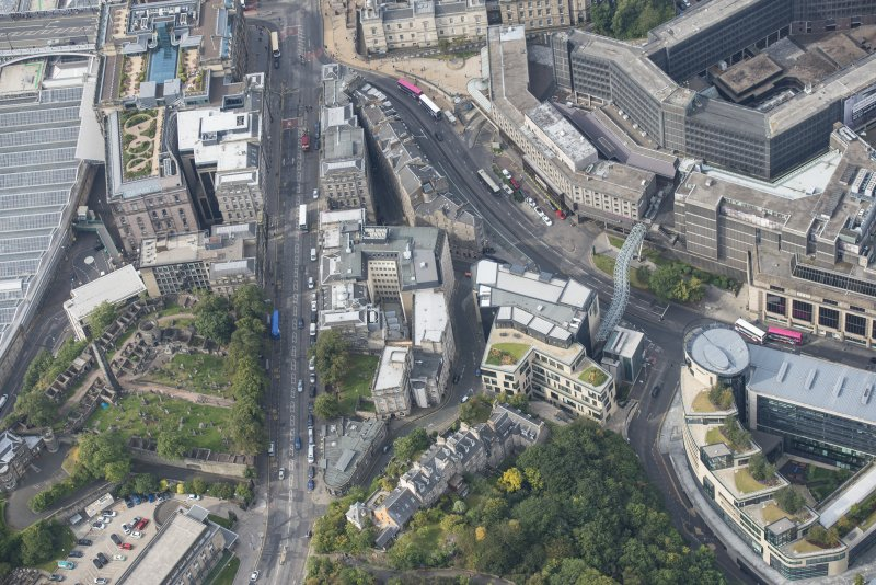 Oblique aerial view of Waterloo Place, Calton Hill Bridge and Leith Street, looking WSW.