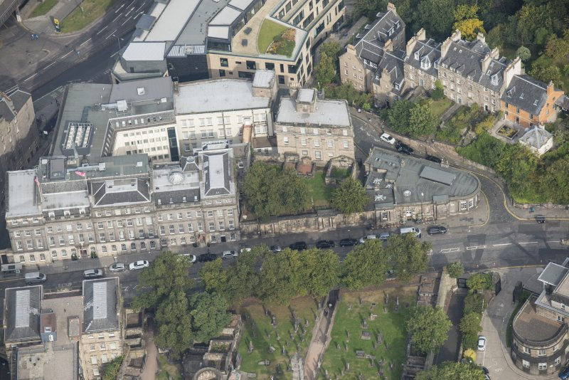 Oblique aerial view of 23 - 29 Waterloo Place, Waterloo Place and Old Calton Burial Ground, looking N.