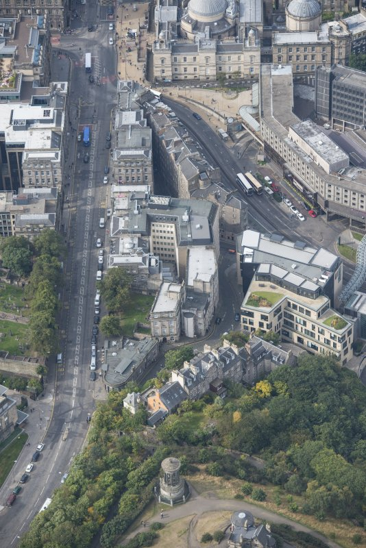 Oblique aerial view of Waterloo Place, Dugald Stewart's Monument and Old Calton Burial Ground, looking WSW.