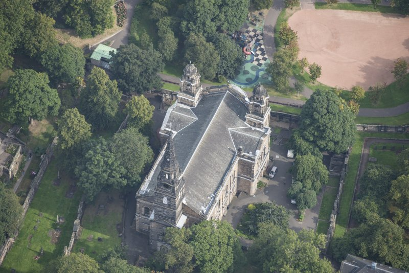 Oblique aerial view of St Cuthbert's Church, looking NNE.
