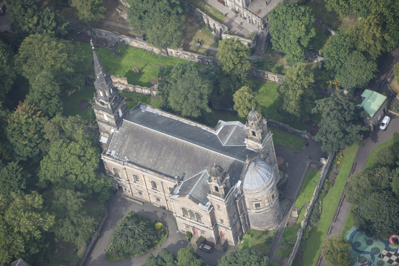 Oblique aerial view of St Cuthbert's Church, looking NNW.