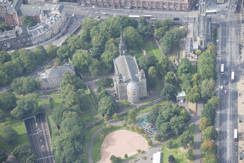 Oblique aerial view of St Cuthbert's Church and Burial Ground and St John's Episcopal Church and Churchyard, looking WSW.