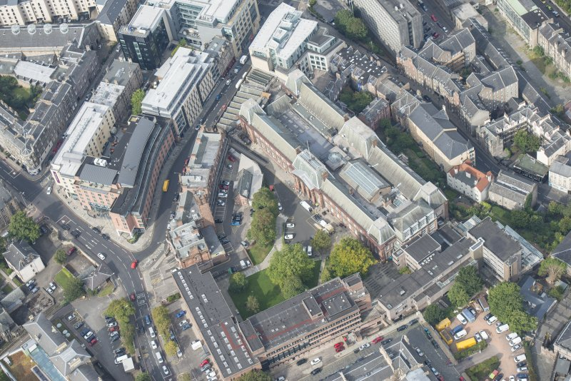 Oblique aerial view of Edinburgh College of Art and Edinburgh Fire Brigade Station, looking NW.