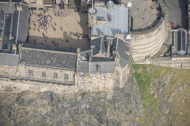 Oblique aerial view of Edinburgh Castle centred on the Great Hall, looking N.