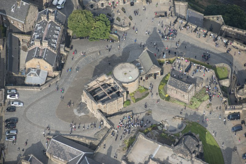 Oblique aerial view of St Margaret's Chapel and Governor's House at Edinburgh Castle, looking NNW.