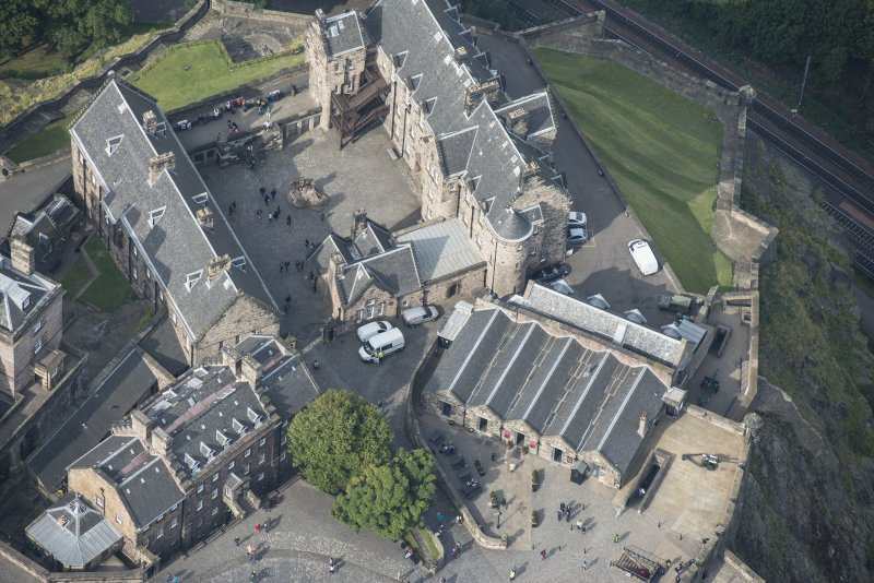 Oblique aerial view of Edinburgh Castle centred on the Governor's House, looking WNW.