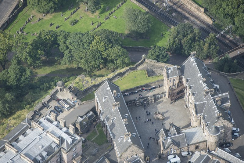 Oblique aerial view of Edinburgh Castle centred on the Butts Battery, looking W.