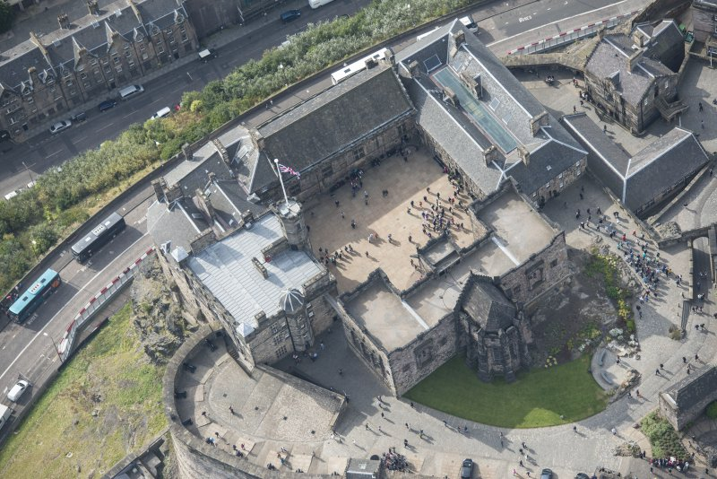 Oblique aerial view of Edinburgh Castle centred on the Palace Yard, looking SW.