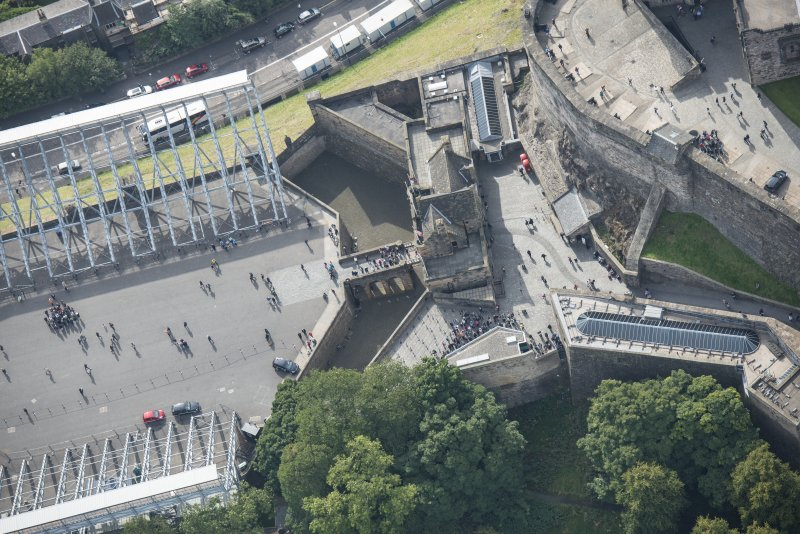 Oblique aerial view centred on the main entrance to Edinburgh Castle, looking S.