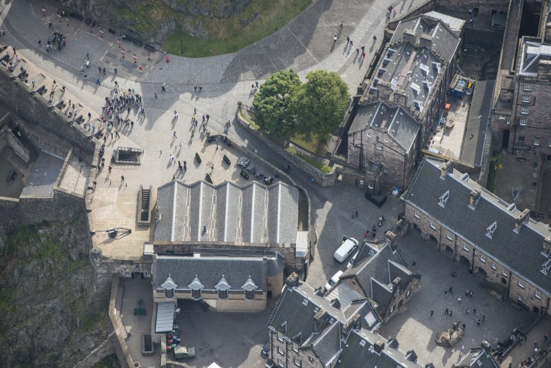 Oblique aerial view of Edinburgh Castle centred on Mills Mount,  looking SE.
