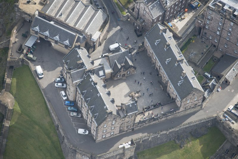Oblique aerial view of Edinburgh Castle centred on the National War Museum of Scotland,  looking E.