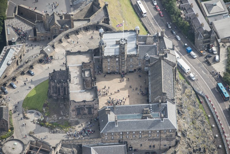 Oblique aerial view of Edinburgh Castle centred on the Palace Yard,  looking E.