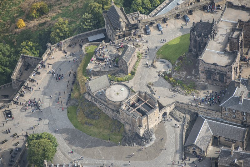Oblique aerial view of Edinburgh Castle centred on St Margaret's Chapel,  looking ENE.