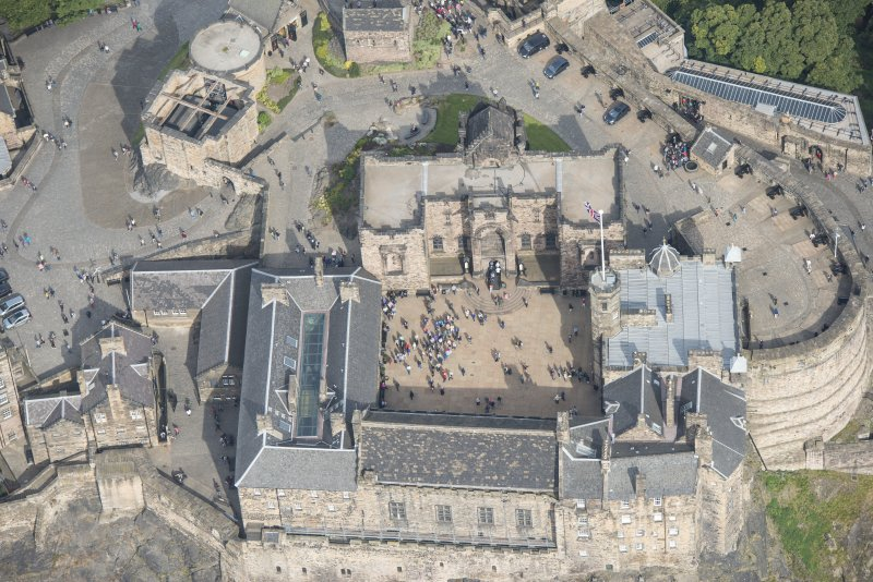 Oblique aerial view of Edinburgh Castle centred on the Scottish National War Memorial,  looking N.