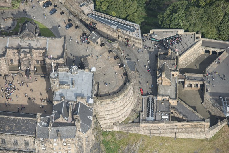 Oblique aerial view centred on the main entrance to Edinburgh Castle, looking N.