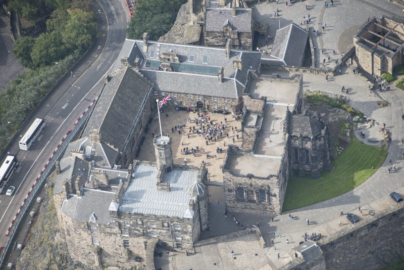Oblique aerial view of Edinburgh Castle centred on the Palace Yard,  looking W.