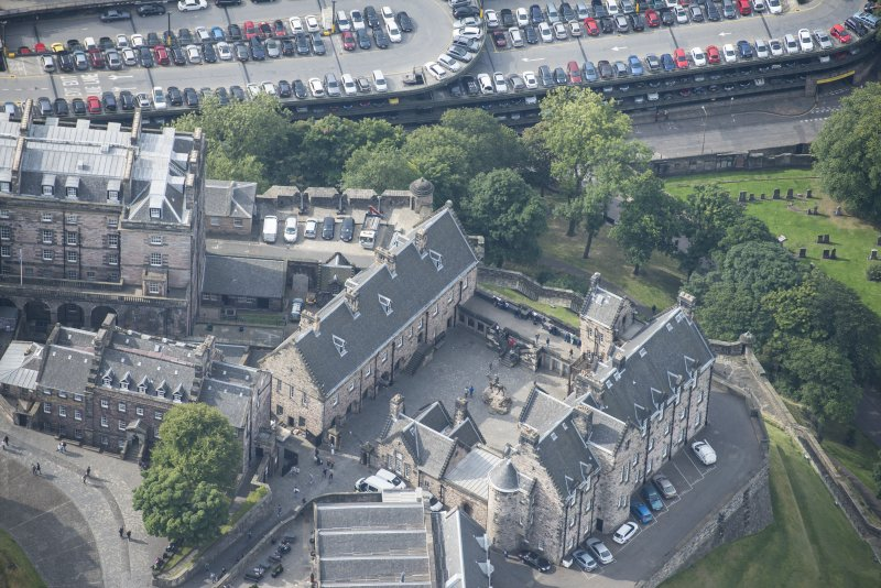 Oblique aerial view of Edinburgh Castle centred on the National War Musuem of Scotland,  looking S.
