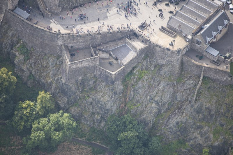 Oblique aerial view of Edinburgh Castle centred on the Argyle Battery,  looking S.