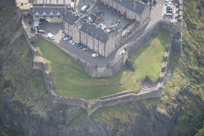 Oblique aerial view of Edinburgh Castle centred on the Western Defences,  looking ESE.