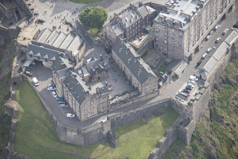 Oblique aerial view of Edinburgh Castle centred on the National War Museum of Scotland,  looking SE.