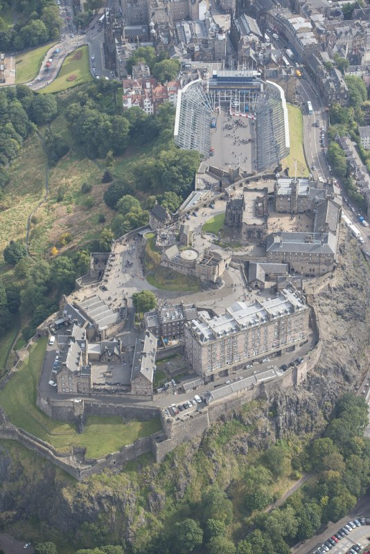 Oblique aerial view of Edinburgh Castle,  looking E.