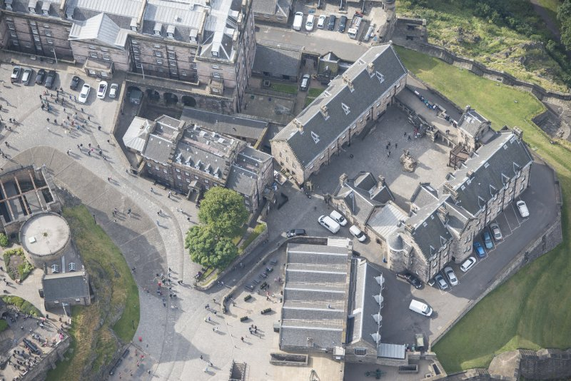 Oblique aerial view of Edinburgh Castle centred on the National War Museum of Scotland, looking SW.